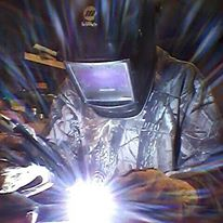 woman welder welding barbiethewelder miller helmet tig gloves